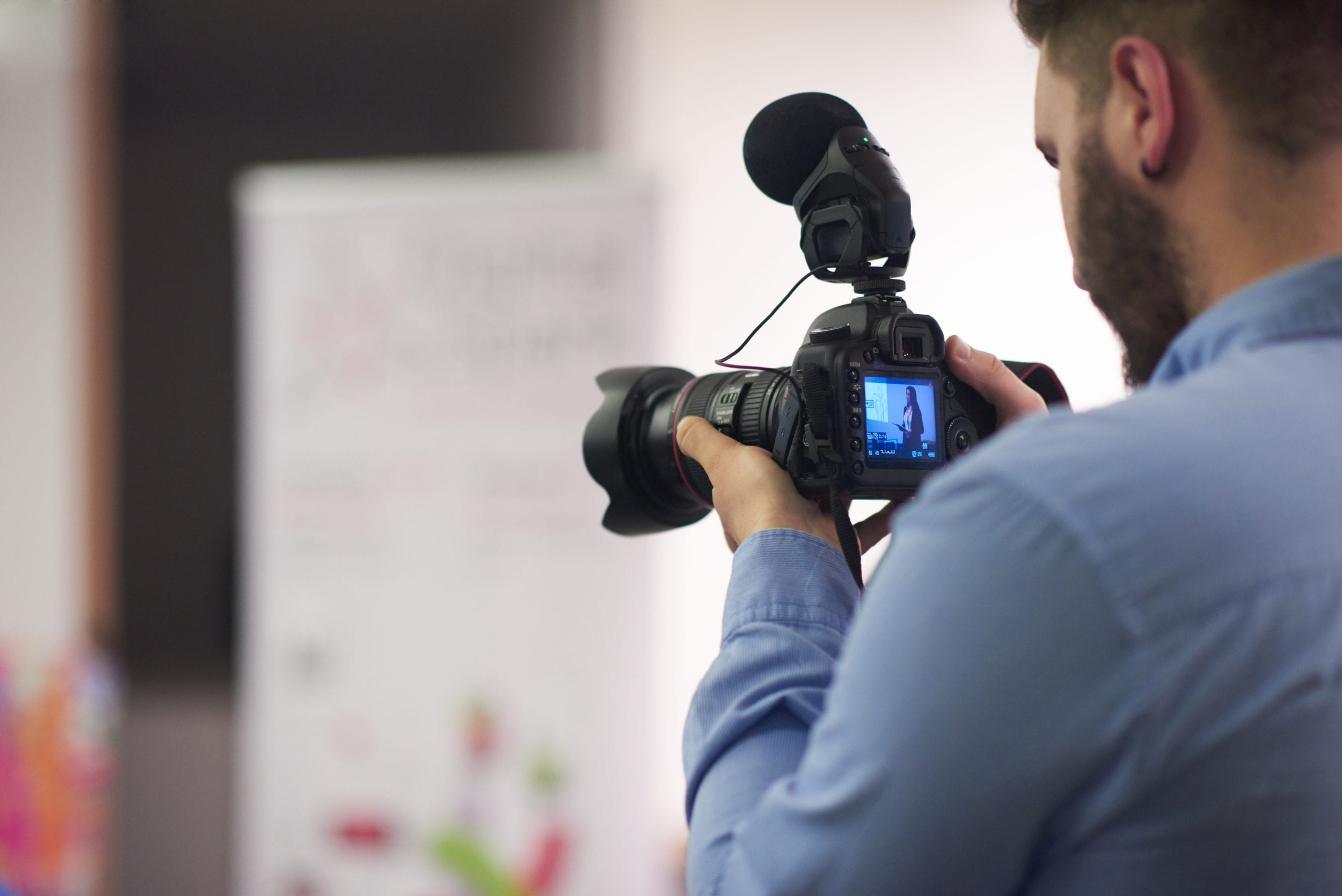 Videographer recording a show